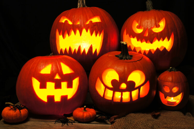Halloween night scene with a group of spooky Jack o Lanterns
